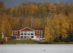 The lakeside Palin residence as seen before 2009 construction began.